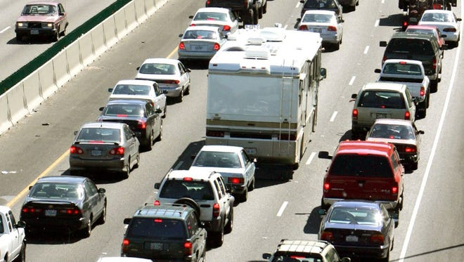 Bumper-to-bumper rush hour traffic moves out of Portland on southbound Interstate 5.