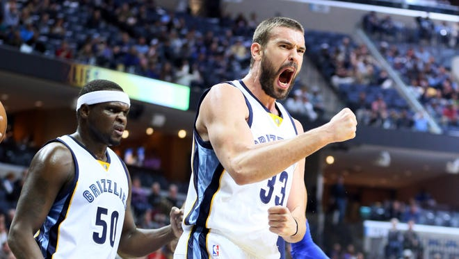 Memphis Grizzlies forward Zach Randolph (50) and center Marc Gasol (33) celebrate after a play against the Dallas Mavericks in the first quarter at FedExForum.