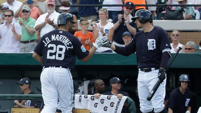 J.D. Martinez gets a high five from Nick Castellanos after homering in the first inning Thursday.