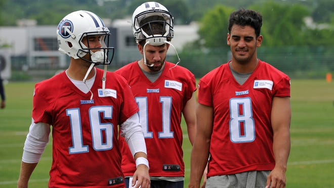 Titans quarterbacks Matt Cassel (16), Alex Tanney (11) and Marcus Mariota (8) walk off the field together after practice May 24.