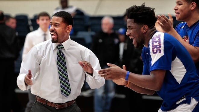 Tennessee State University Assistant Basketball Coach Rodney Hamilton (left) helps get the Tigers pumped up before a game against Alcorn during the Heritage Hardwood Classic on Dec. 19, 2015.