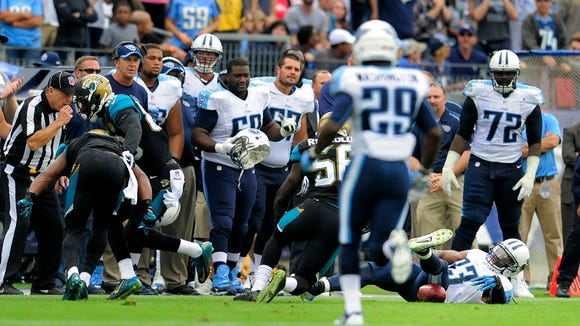 Titans free safety Michael Griffin (33) loses the football on an onside kick by the Jaguars late in fourth quarter at LP Field Sunday Oct. 12, 2014, in Nashville, Tenn.