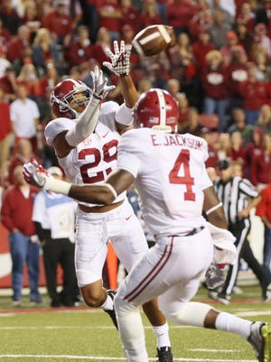 Alabama defensive back Minkah Fitzpatrick (29) intercepts a pass against Arkansas and returns it for a touchdown during the fourth quarter Saturday.
