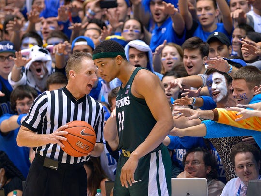 Cameron Crazies taunt Miles Bridges, as he talks with official Mike Eades during MSU's 78-69 loss to Duke in Durham, N.C. on Nov. 29, 2016.