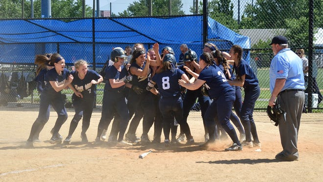 Ramsey's Ryan Henry is congratulated by her team after hitting a home run in the game against Dumont during the Bergen County softball tournament semifinals.
