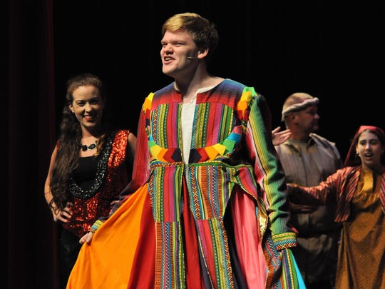 """Nick Scalfano (middle) acts as Joseph in Lagniappe Theatre Company's production of """"Joseph and The Amazing Technicolor Dreamcoat."""""""