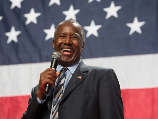 Presidential candidate Dr. Ben Carson smiles as he