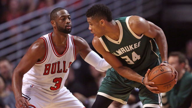 Milwaukee Bucks forward Giannis Antetokounmpo (34) is defended by Chicago Bulls guard Dwyane Wade (3) during the first half at the United Center.
