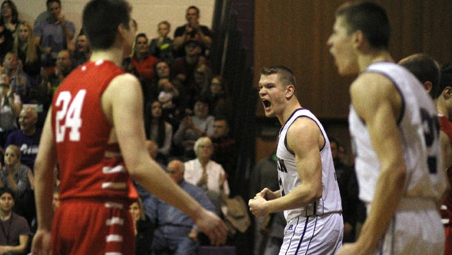 Dryden forward Stuart Stahlman reacts after being fouled on a layup in the third quarter of Friday night's matchup against 7th-ranked Waverly. Dryden would go on to win,  68-42.