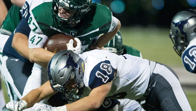 Greeneville's Ty Youngblood tries to gain yards against Anderson County on Friday, November 17, 2017.