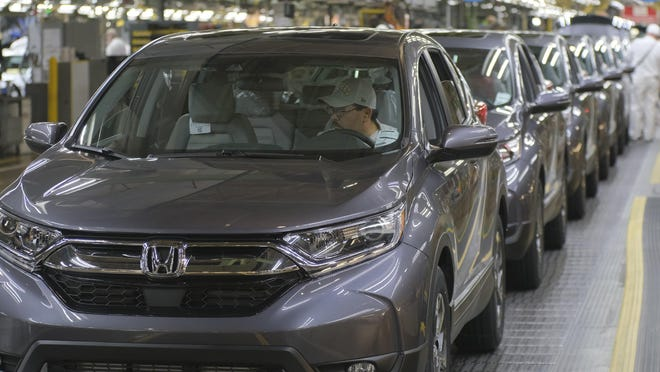Honda CR-Vs roll off the assembly line at the Honda manufacturing plant in Marysville.