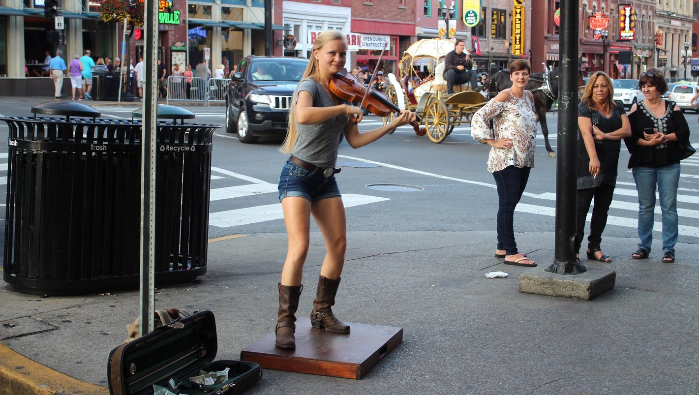 MTSU grad Hillary Klug uses her feet and fiddle to busk ... Hillary Klug