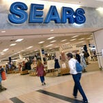 In this Monday, May 14, 2012, file photo, shoppers walk into Sears in Peabody, Mass.