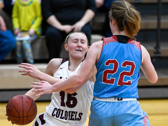 Henderson's Alyssa Dickson (15) drives around Union County's Jralee Roberson (22) as the Henderson County Lady Colonels play district rival the Union County Braves at Colonel Gym Monday, January 22, 2018.