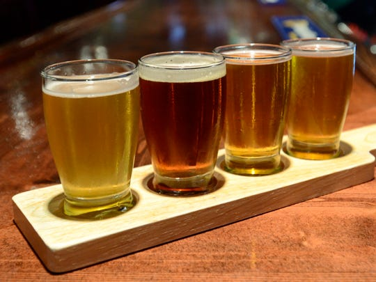 A flight of craft beer, including Eliot Ness lager from Great Lakes Brewing Company, second from left.