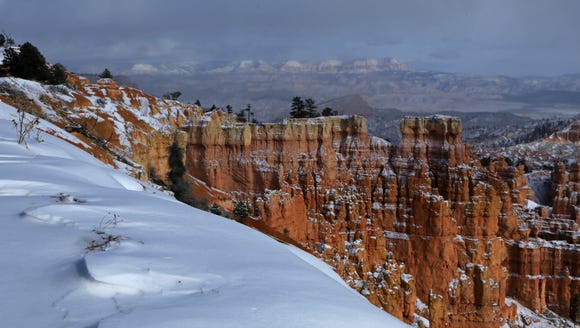 Snow drifts along the amphitheater rim in Bryce Canyon