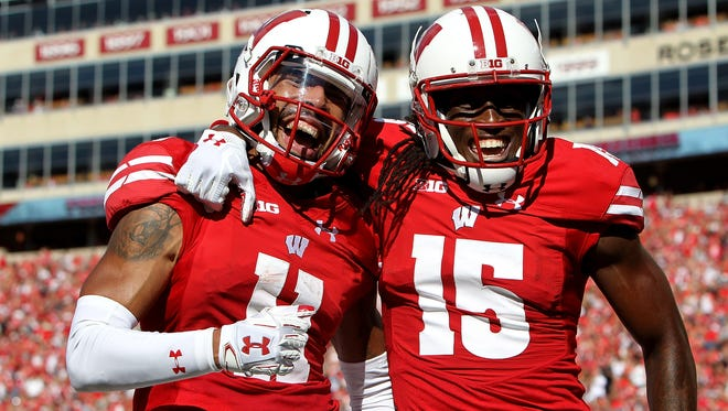 Wiconsni's Jazz Peavy, left, and Robert Wheelwright celebrate after Peavy scored a touchdown in the second quarter in the win over Akron.