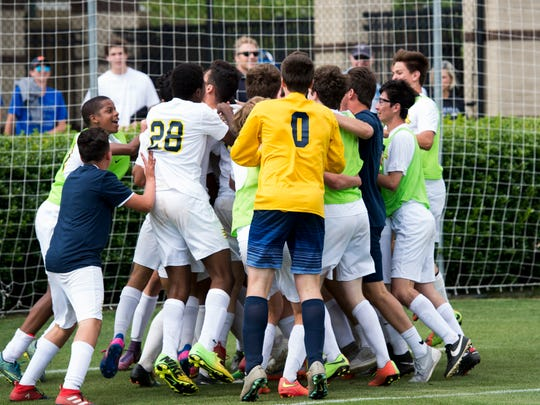 Lausanne players huddle around senior Gabriel Castro after he scored the game-winning goal at their championship game on May 25, 2017.