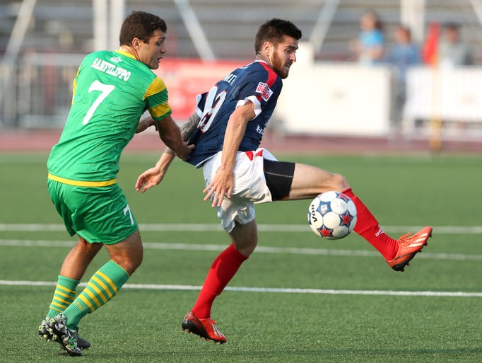 Indy Eleven's Blake Smith moves the ball against Tampa Bay Rowdies' Frankie Sanfilippo in the first half of the game Saturday July 19, 2014 at Carroll Stadium.