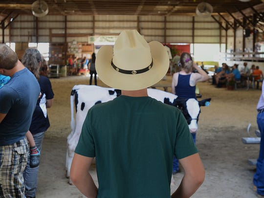 St. Clair County 4-H and Youth Fair participants wait to show their dairy cows.