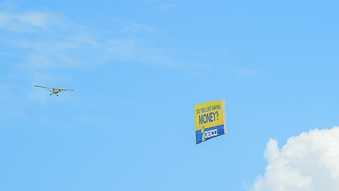 An airplane pulling an advertisement banner flies over St. Augustine Beach on Sunday, August 2, 2020. An effort to ban similar aerial advertising in Nashville failed amid concerns from Metro Council members and the Nashville Airport Authority.