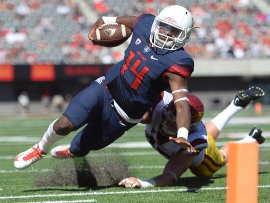 Arizona Wildcats quarterback Khalil Tate (14) is tackled