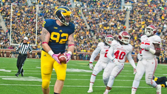 Michigan tight end Keith Heitzman (92) makes a touchdown catch against Indiana in Ann Arbor on Nov. 1, 2014.