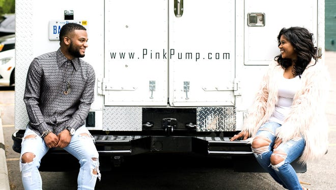Vincent, left, and Kelly Kirkwood with their Pink Pump truck.