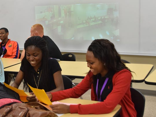 Leesville High School students KeKe Culbert (left) and Alyssa Turner are dual enrolled in a biology course through Northwestern State University in Natchitoches. The class is being taught through compressed video (back, on wall) along with students at Hicks High School. New classrooms and buildings at Leesville High School were being utilized Tuesday, the first day of school in Vernon Parish.