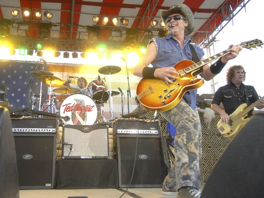 Ted Nugent performs to fairgoers in the grandstands