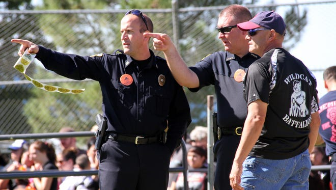 From left, Cpt. Bobby Orosco, Chief Brandon Gigante and Mayor Benny Jasso organized the Great Pumpkin Candy Drop last October as part of the Deming Police Department's public relations program to boost   visibility in the community and to gain acceptance.