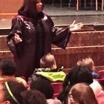Dr. Mary Webb talks to her fourth-graders following the ceremony where she received her doctorate from Miami University.