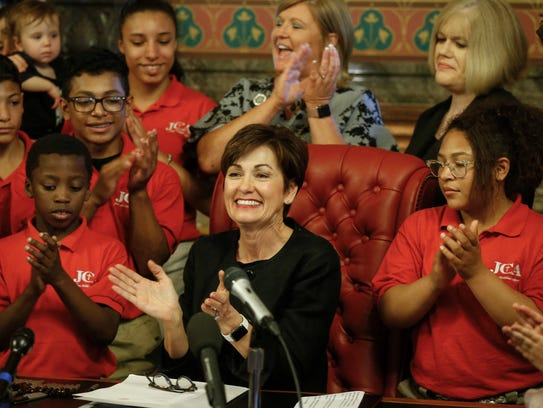 Iowa Gov. Kim Reynolds signs into law SF 359, the fetal