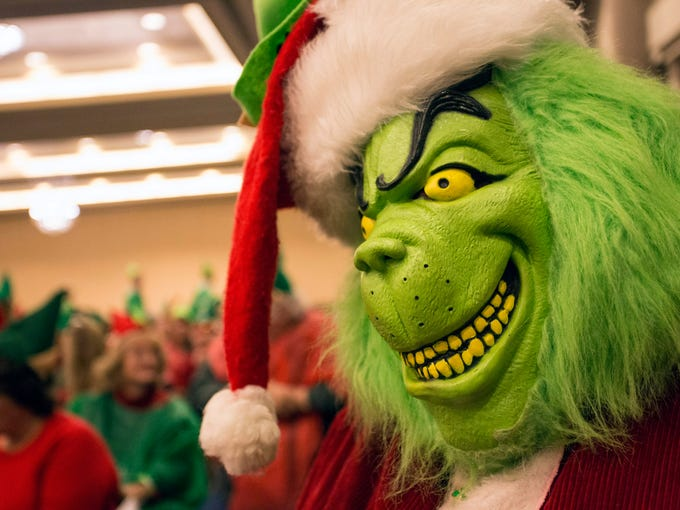 The Grinch checks out the 639 elves assembled in the