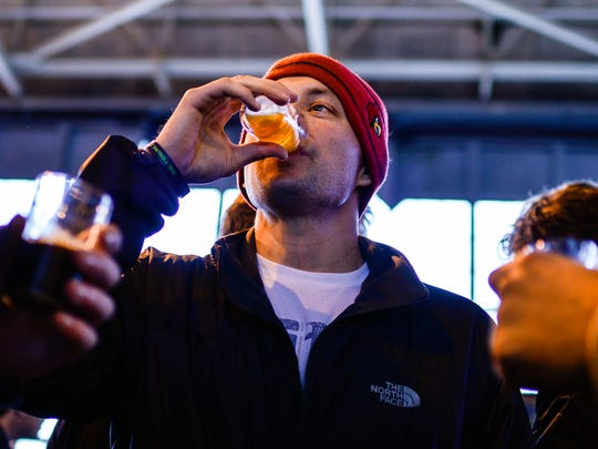 Eric Shackelford, 32, of Louisville enjoys an IPA from West 6th Brewing during the Tailspin Ale Fest at Bowman Field. The festival features 56 breweries from across the country.