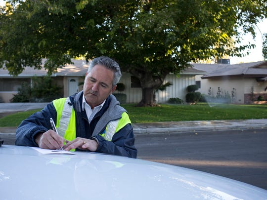Water investigator Kern writes a warning ticket for the homeowner who was watering on the wrong day in the  Las Vegas Valley Water District.
