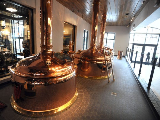 New copper brewing kettles sit inside the new Serra Nevada Taproom and restaurant as employees prepare the official opening at the Mills River brewing facility located at 100 Sierra Nevada Way in Fletcher Monday March 9, 2015.