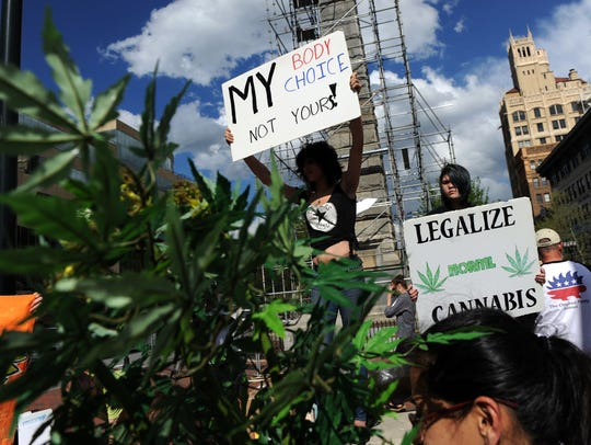 Marijuana supporters rallied at Vance Monument in downtown