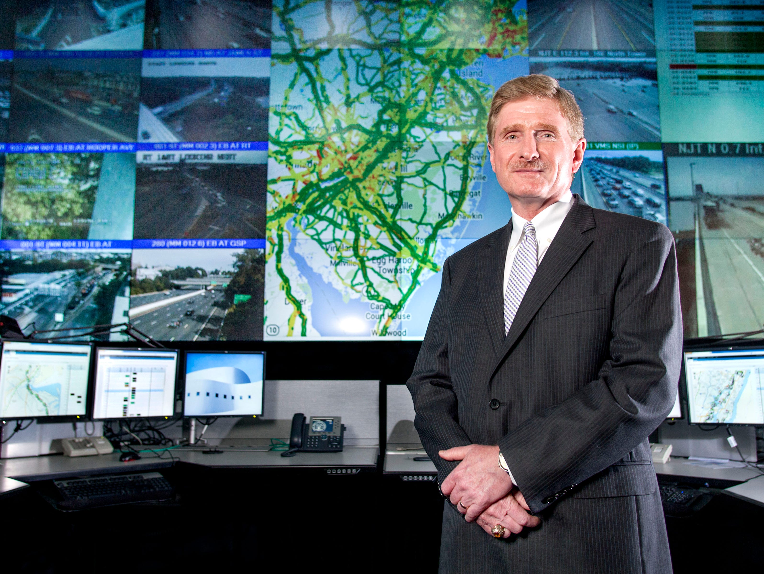 New Jersey Turnpike Authority CIO Barry Pelletteri at the New Jersey Turnpike Authority transit control center in Woodbridge, N.J., in front of an IBM transportation management solution that will help minimize congestion and improve traffic flow for
