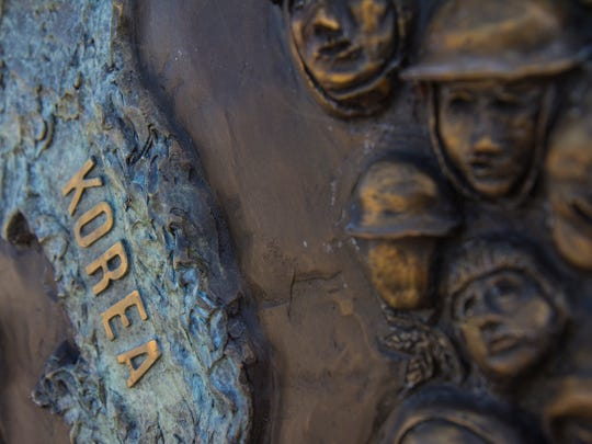"""Detail of the """"Faces of War"""" panel commemorating the"""
