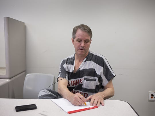 Chris Simcox answers questions during a jailhouse interview June 10, 2015, in the Chapel at the Lower Buckeye Jail in Phoenix.