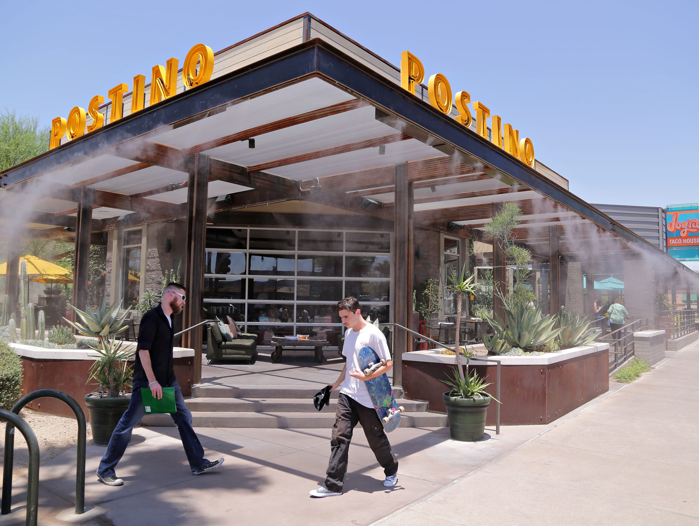 Lunch time patrons flock to restaurants such as Postino
