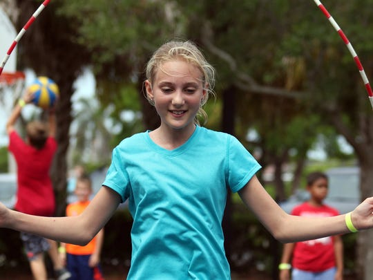 File: Cambri Mushrush gets a little outdoor exercise during a Camp Mackle session.