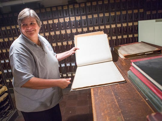Nancy Sorrells shows off original records stored inside