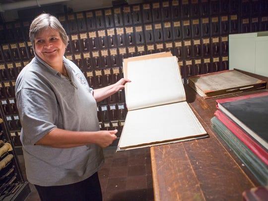 Nancy Sorrells shows off original records stored inside