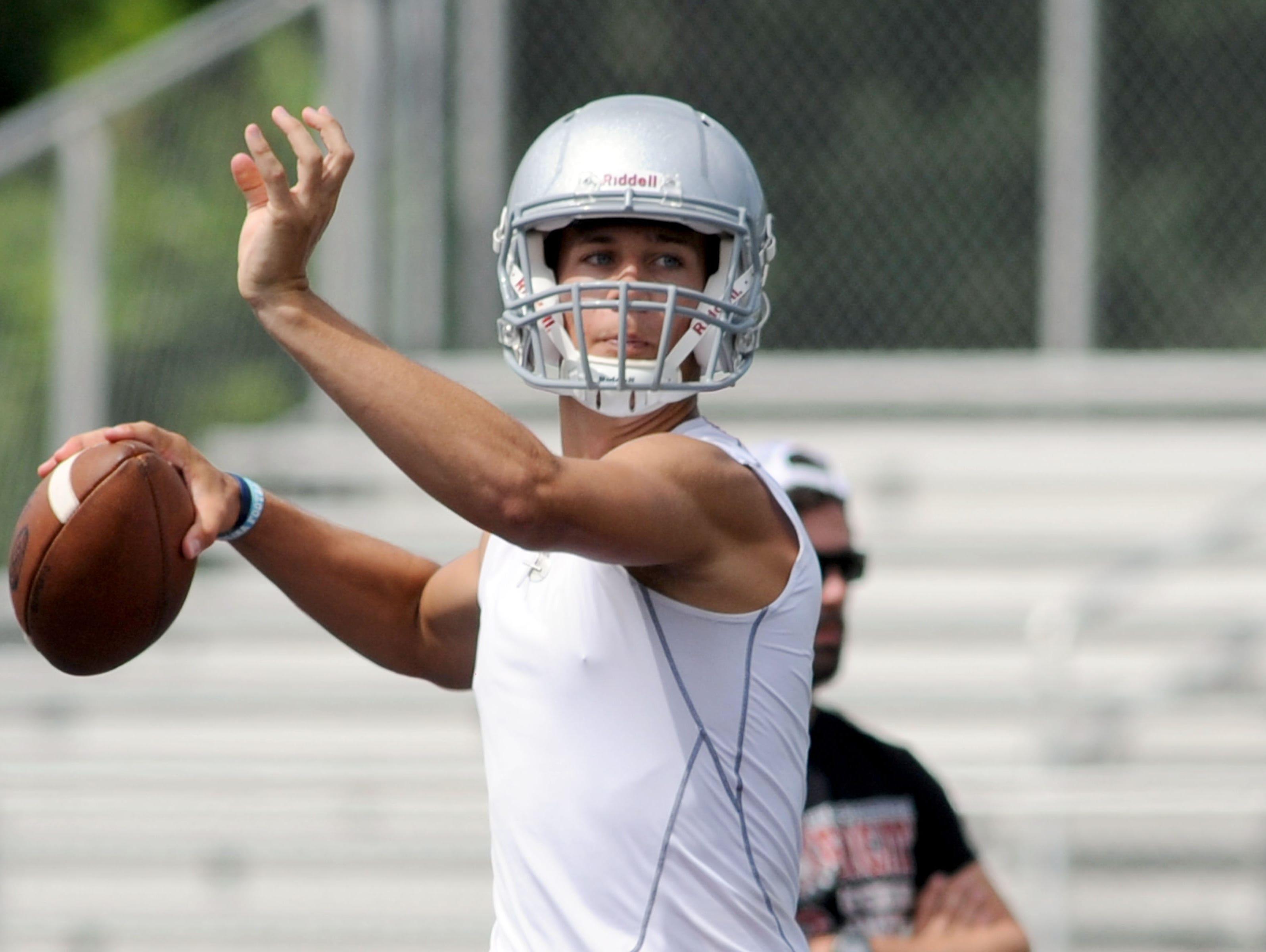 Hendersonville quarterback Michael Schmidt passed for a Western North Carolina-best 3,004 yards in 2014.