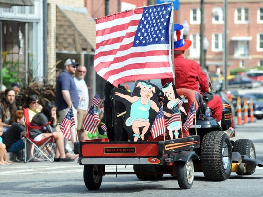 Hundreds lined downtown Canton Monday morning to watch the near hour-long annual Labor Day Parade. It was the 109th running of the parade with plenty of flying candy and cheers for American pride.