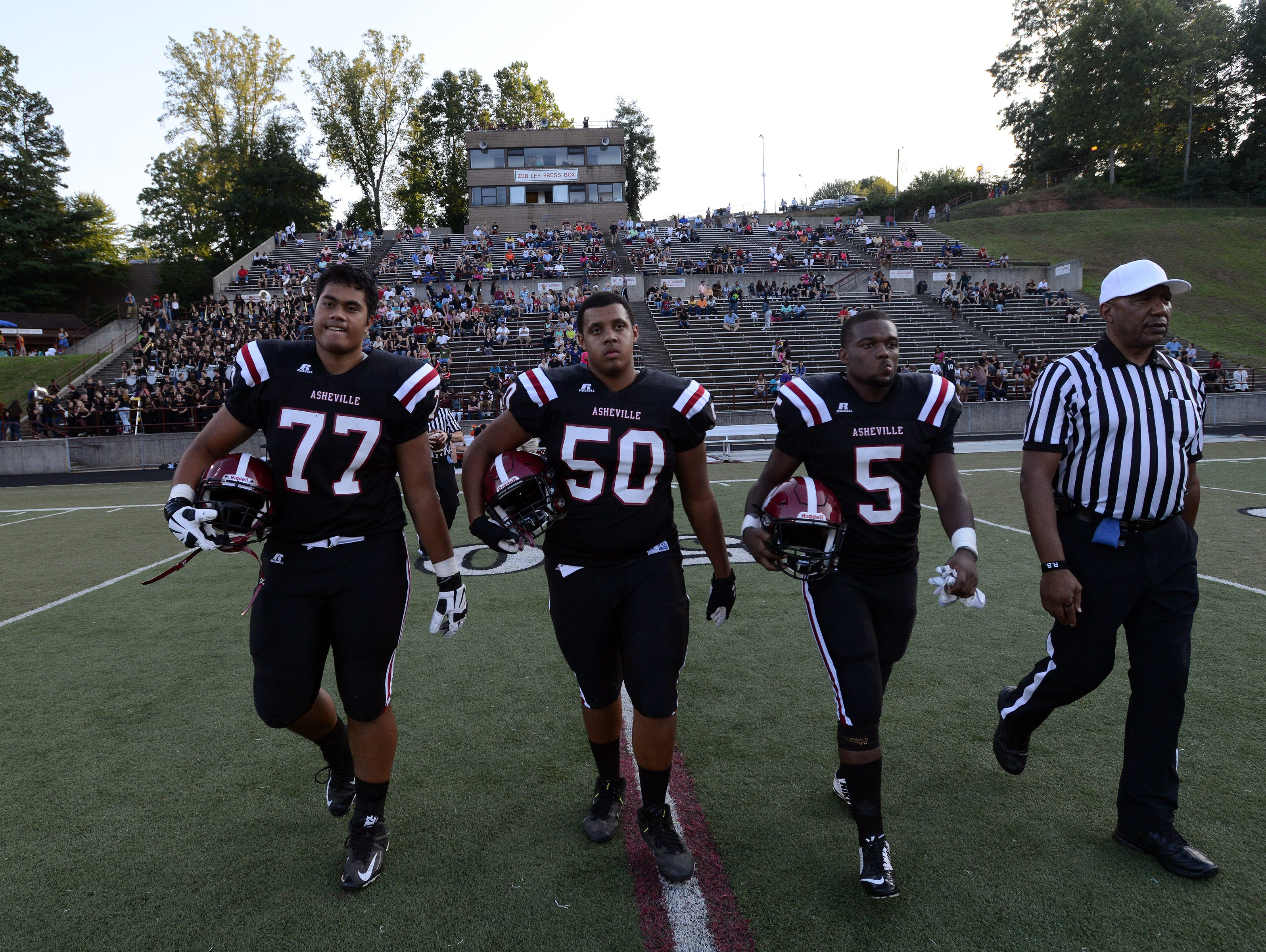 Asheville High football players, from left to right, Pete Leota, Cade Pearson and Reggie Battle