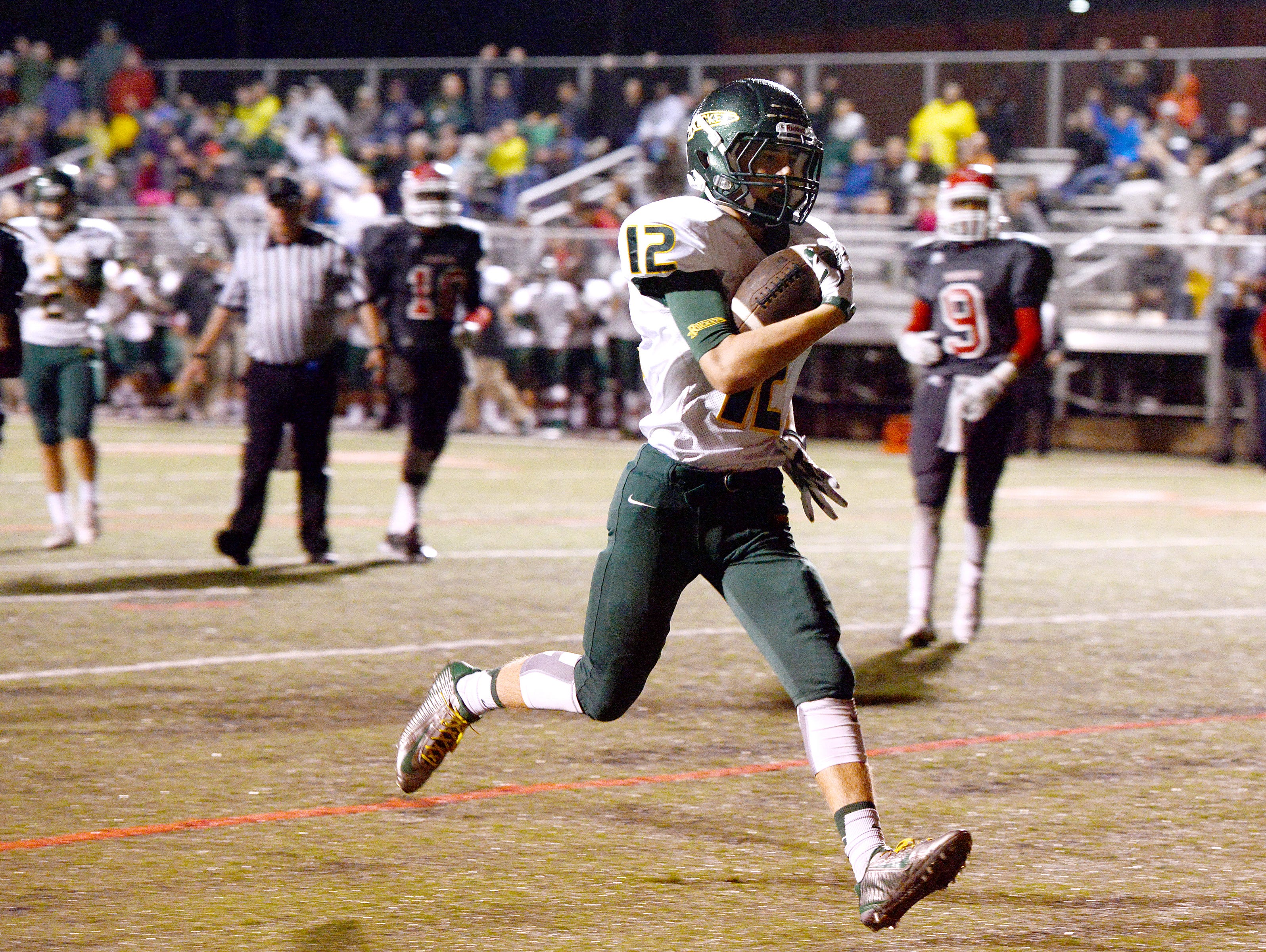 Reynolds' Nathan St. Onge rushes for a touchdown Friday at Erwin.