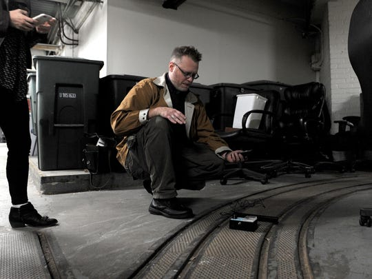 Paranormal Investigator Joshua Warren takes a reading in the Citizen-Times basement during an investigation last Thursday, Oct. 16, 2014.